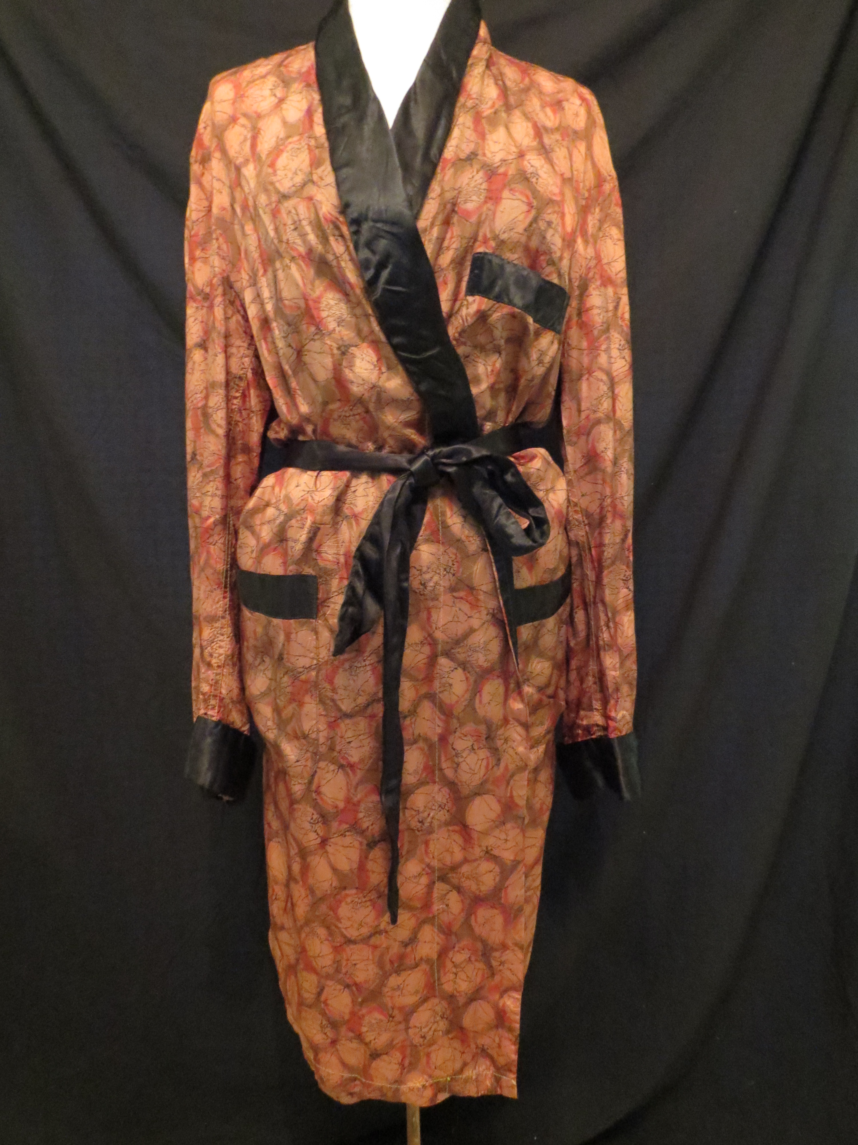 A FAVORITE MEN'S RAYON BATHROBE WITH AN ATOMIC PRINT FROM THE 1940'S - 1950'S